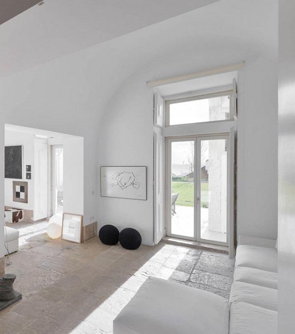casa a Lisbona - living con pavimento in pietra